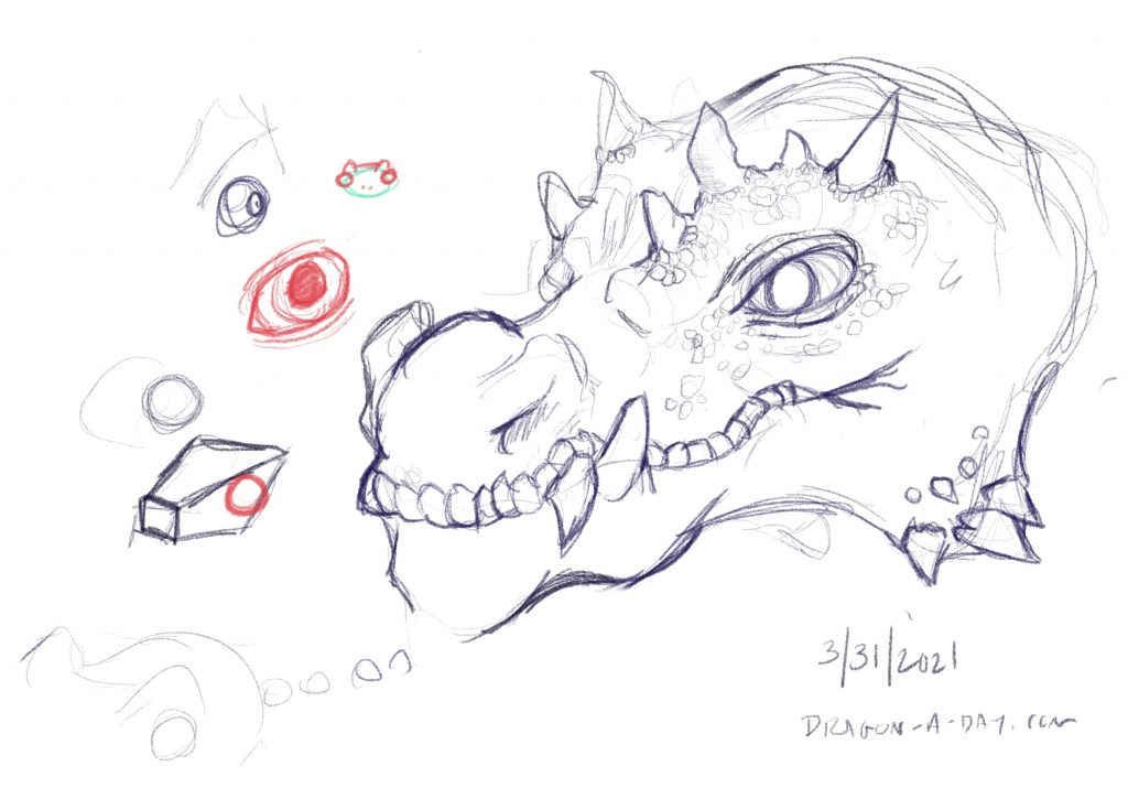 Sketch of a dragon's head. Smaller sketches of eyes and heads are on the side.